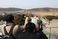 Visitors look toward North Korea at the Imjingak observation post near the demilitarized zone separating South Korea and North Korea in Paju, South Korea. The DMZ is just 35 miles north of Seoul. (Chung Sung-Jun/Getty Images)