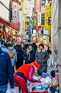 The Myeong-dong shopping district offers top-notch people-watching and two of the country's biggest luxury department stores.(Christopher Reynolds/Los Angeles Times)