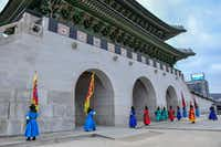 Twice daily, crowds gather for the ceremonial changing of the guard at the Gwanghwamun Gate of Gyeongbokgung Palace. The ceremony is conducted by actors with fake mustaches, not actual guards.(Christopher Reynolds/Los Angeles Times)
