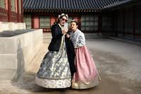 Visitors in traditional clothing take a selfie at Gyeongbokgung Palace.(Chung Sung-Jun/Getty Images)