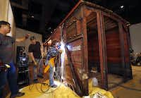 Ron Siebler and his restoration team expect to complete the boxcar's installation at the new West End museum this week.(Tom Fox/Staff Photographer)