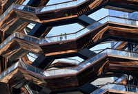 "<p>The Hudson Yards development includes <span style=""font-size: 1em; background-color: transparent;"">a 16-story sculpture called the Vessel, a honeycomb spiral staircase that's meant to be climbed.</span></p>(Angela Weiss/Agence France-Presse)"