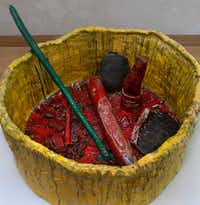 <p>Sterling Ruby's <i>Basin Theology</i> suggests a gigantic ashtray filled with puzzling objects.</p>(Nan Coulter)