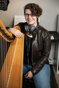 Portrait of Kimberley Osberg with her harp at her Dallas home. (Carter Rose/Special Contributor)