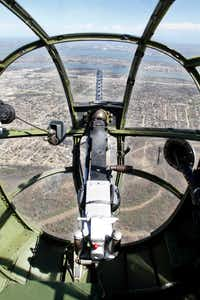 The view looking over a .30 caliber machine gun from the bombardier/navigator seat in the front nose of a North American B-25 Mitchell Bomber as the plane flies over North Texas during a media flight on Wednesday, March 13, 2019. The bomber is part of Collins Foundation's Wings of Freedom Tour at the Frontiers of Flight Museum.(Brian Elledge/Staff Photographer)