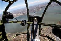 The view looking over a .30-caliber machine gun from the bombardier/navigator seat in the front nose of a North American B-25 Mitchell Bomber as the plane flies over Lake Ray Hubbard during a media flight on Wednesday, March 13, 2019. The bomber is part of Collins Foundation's Wings of Freedom Tour at the Frontiers of Flight Museum.(Brian Elledge/Staff Photographer)