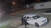 Dallas police released a still image of two men trying to get into a white SUV near where a 20-year-old man was shot to death Wednesday night.(Dallas Police Department)