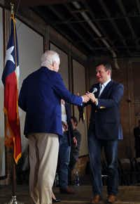 Sen. Ted Cruz (right) takes the microphone from Sen. John Cornyn after Cornyn introduced Cruz  during a rally at Gilley's in Dallas on Oct. 24, 2018.(Daniel Carde/Staff Photographer)