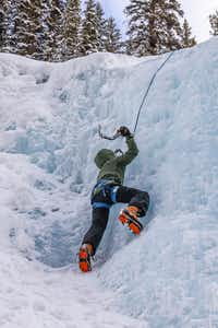 Reid Irwin, 11, climbs a frozen waterfall in Johnston Canyon.(Brian Irwin/Special Contributor)