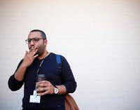 """Mohamed Khattab, 27, smokes a cigarette outside El Centro College in downtown Dallas. Khattab, who started smoking when he was 20-years-old, thinks it's appropriate that lawmakers are thinking of raising the legal age to 21, """"because I'm trying to quit now,"""" he said.(Rose Baca/Staff Photographer)"""