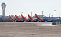 Five Southwest Airlines Boeing 737 Max jets are grounded at Sky Harbor International Airport in Phoenix. (Matt York/The Associated Press)