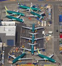 Boeing 737's, many of which are MAX 8 and 9's in various stages of completion, are parked next to the 737 factory across the runway from the Renton Municipal Airport in King County, Wash., on March 15, 2019. (Mike Siegel/The Seattle Times)