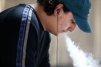 """Aubrey Williams, 19, vapes outside El Centro College in downtown Dallas on Monday, March 18, 2019. """"I use it as a stress reliever,"""" Williams said. Williams, who has been vaping since he was 13-years-old, thinks lawmakers shouldn't try to raise the legal age.(Rose Baca/Staff Photographer)"""