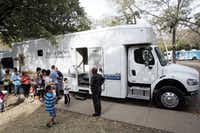 Men and women waited outside the Dallas County Health and Human Services bus to receive STD tests during a health fair hosted in Dallas with the Mexican Consulate in 2015.(File Photo)