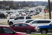 Traffic backs up at evening rush hour on U.S. Highway 380 near Lake Forest Drive in McKinney.(Ashley Landis/Staff Photographer)