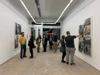 Interior at the opening of the exhibition of paintings and video works by Belgian artist collective Leo Gabin at Sean Horton (presents) on West Jefferson Boulevard in Dallas.(Nan Coulter)