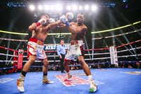 Mikey Garcia and Errol Spence Jr. box during the first round of a IBF World Welterweight Championship match on March 16, 2019, at AT&T Stadium in Arlington.(Ryan Michalesko/Staff Photographer)
