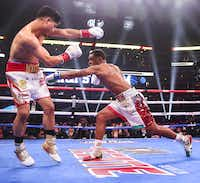 Mikey Garcia dodges a punch by Errol Spence Jr. during a IBF World Welterweight Championship match on March 16, 2019, at AT&T Stadium in Arlington.(Ryan Michalesko/Staff Photographer)