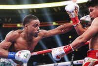 Errol Spence Jr. lands a punch on Mikey Garcia during a IBF World Welterweight Championship match on March 16, 2019, at AT&T Stadium in Arlington.(Ryan Michalesko/Staff Photographer)