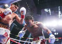 Mikey Garcia lands a shot on Errol Spence Jr. during a IBF World Welterweight Championship match on March 16, 2019, at AT&T Stadium in Arlington. Spence beat Garcia by decision.(Ryan Michalesko/Staff Photographer)