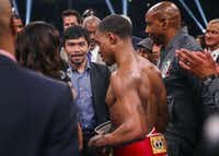 Errol Spence Jr. speaks with Manny Pacquiao onstage following his win over Mikey Garcia in a IBF World Welterweight Championship match on March 16, 2019, at AT&T Stadium in Arlington.(Ryan Michalesko/Staff Photographer)