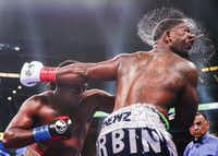 Charles Martin lands a punch on Gregory Corbin during a Heavyweights match on March 16, 2019, at AT&T Stadium in Arlington, Texas.(Ryan Michalesko/Staff Photographer)
