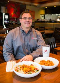 Pei Wei CEO J. Hedrick poses with the restaurant's new orange chicken dishes.(Ashley Landis/Staff Photographer)