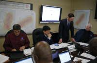 Dallas County Judge Clay Jenkins (standing) talks on a conference call in the policy room during a simulated EF-4 tornado strike at the Dallas County Emergency Operations Center in Dallas on Thursday, March 21, 2019. This was the largest severe weather exercise ever conducted in the D-FW area. (Vernon Bryant/Staff Photographer)