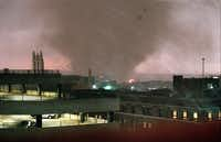 A tornado crosses the Trinity River on the west side of Fort Worth and heads for downtown on March 28, 2000. The Mallick Tower is pictured just at the base of the tornado.(Carolyn Bauman/Star-Telegram/STAR-TELEGRAM)