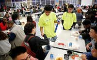 Duncanville High School freshman David Mojica (center) shakes hands with senior Paul Zamora who says he'll sign up to be a bone marrow donor during lunchtime in the high school cafeteria, Thursday, March 21, 2019. The marrow drive was for Mojica, who has aplastic anemia, a rare and life-threatening blood disorder. (Tom Fox/Staff Photographer)