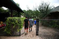 Boys from the emergency shelter walk through the courtyard at Jonathan's Place. (2017 File Photo /Rose Baca)