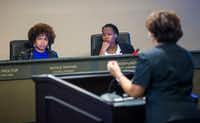 From left, DeSoto City Council members Nicole Raphiel and Kay Brown-Patrick listen to Crystal Owens, DeSoto's managing director of development services, during a DeSoto City Council meeting.(Daniel Carde/Staff Photographer)