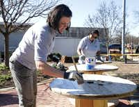 Jaime Bretzmann, left, and Nalini Joshi paint tables at the Environmental Education Center in Plano Thursday.(Jason Janik/Special Contributor)