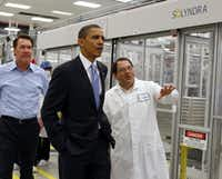 In this May 26, 2010 file photo, President Barack Obama is given a tour of Solyndra by Executive Vice President Ben Bierman as Chief Executive Officer Chris Gronet (left) walks along at Solyndra Inc. in Fremont, Calif. (Paul Chinn/AP)