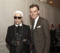 Karl Lagerfeld (left) and Ken Downing are pictured at the Chanel awards ceremony at Neiman Marcus in downtown Dallas on Dec. 11, 2013.(File Photo/Staff)
