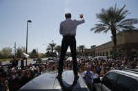 Democratic presidential candidate and former Texas congressman Beto O'Rourke speaks from the roof of his car to an overflow crowd at a campaign stop at a coffee shop Sunday, March 24, 2019, in Las Vegas. (John Locher/AP)