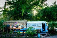A bus is parked next to its own tiki bar at the Shady Dell Vintage Trailer Court in Bisbee, Ariz.(Kelly and Sergio Photography/The Shady Dell)
