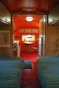 At the Sou'wester Historic Lodge and Vintage Travel Trailer Resort in Seaview, Wash., a dining table is situated on the other side of the kitchen, as seen from an Airstream's sleeping area and bathroom.(Erin E. Williams/The Washington Post)