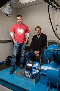 Brad Hunstable (left) and his father, Fred Hunstable, co-founded Linear Labs. They plan to license their motor system to major auto manufacturers and other companies.(<br>/Courtesy of Linear Labs)