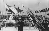 Flags of many countries were carried during dedication ceremonies for Dallas-Fort Worth International Airport in 1973.(The Associated Press)