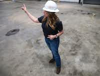 Chris Mullen, vice president of research at Solera, walks around a warehouse that will be transformed into a next-generation auto research and training center. She said the center will help boost the talent pipeline as the auto industry faces a technician shortage.(Ryan Michalesko/Staff Photographer)