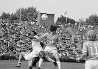 """<p><span style=""""font-size: 1em; background-color: transparent;"""">Dallas Tornado midfielder Bobby Moffat (14) goes up for a header against New York Cosmos star Pelé during a June 1975 exhibition game at Downing Stadium on Randall's Island in New York.</span></p>(The Associated Press/1975 File Photo)"""
