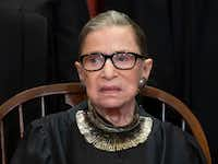 That necklace on Associate Justice Ruth Bader Ginsburg is sold by Stella & Dot. Wearing big necklaces with her black robe is a signature look for Supreme Court Justice Ginsburg.  (J. Scott Applewhite/The Associated Press)