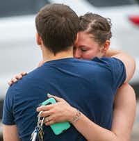 Scott Bowers embraces his fiancée, Kimberly Wohled, after authorities escorted him out of his apartment at La Valencia at Starwood.(Shaban Athuman/Staff Photographer)
