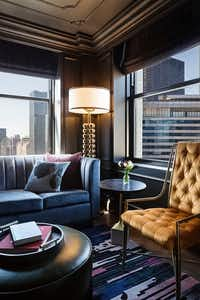 Guest rooms in the Tower at St. Jane, a luxury boutique hotel within a hotel, have large picture windows with views of the surrounding city.(St. Jane Hotel)
