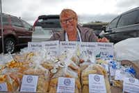 The chilly wind may have been whipping Debbie Zess  hair around, but she was all smiles at the Cowtown Farmers Market in Fort Worth, selling her Gotta Have Cookies.(Kim Pierce/Special Contributor)