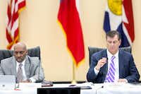 Dallas City Manager T.C. Broadnax, left, listens along with  Mayor Mike Rawlings, right, during a Dallas City Council meeting at Park In the Woods Recreation Center in Dallas on Wednesday, Feb. 13, 2019. (Shaban Athuman/Staff Photographer)