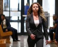 Former Dallas police Officer Amber Guyger (left) walked the hallway after court date at the Frank Crowley Courts Building in Dallas on Monday, March 18. Guyger is charged with murder in the Sept. 6 shooting death of Botham Jean in his own apartment. (Vernon Bryant/Staff Photographer)