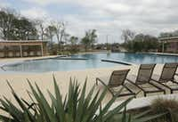 The Trinity Falls community of new homes includes a pool and lounging area.(Jason Janik/Special Contributor)