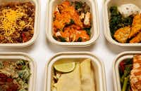Snap Kitchen meals, including bison quinoa hash, romesco chicken, chicken tenders with turnip mash, naked salmon, chicken tinga tacos, creamy mushroom fusilli. (Vernon Bryant/Staff Photographer)